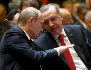 epa04510989 A handout picture provided by Turkish Presidential Press Office shows Russian President Vladimir Putin (L) and his Turkish counterpart Recep Tayyip Erdogan (R) chatting before a press conference in the new presidential palace in Ankara, Turkey, 01 December 2014. Putin and Erdogan began a meeting in Ankara to discuss their often opposing views on the crisis in Syria, the Islamic State threat and gas supplies to Turkey. Russia agreed to send more gas to Turkey and charge 6 per cent less for the energy, starting in January. Putin is on a one-day official visit to Turkey. EDITORIAL USE ONLY, NO SALES  EPA/TURKISH PRESIDENTIAL PRESS OFFICE / HANDOUT