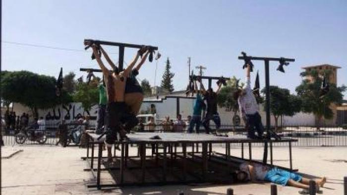 Convert or die. ISIS militants are crucifying victims because to them crucifixion is especially humiliating due to its Christian implications.