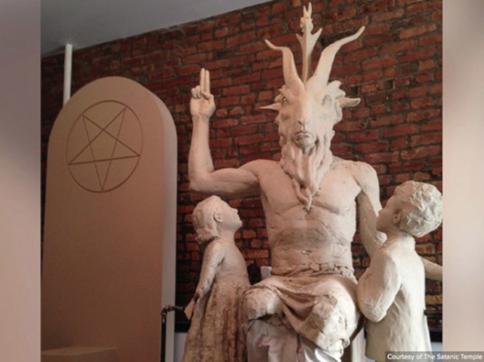 """The Satanic Temple also claims to be active in politics, ""facilitating the communication and mobilization of politically aware Satanists."" The group made headlines earlier this year when it proposed to place a 2-meter-tall statue of Baphomet in front of the Oklahoma state capitol next to a statue of the 10 Commandments, citing their freedom of religion rights under the US Constitution."""